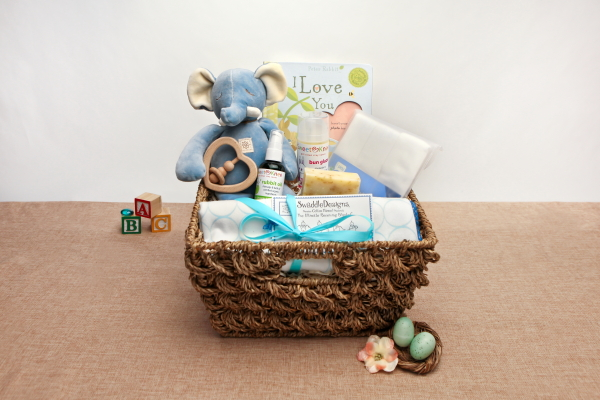 "Our Large Organic Baby Gift Basket includes an ivory twill Baby Hooded Bath Towel, two matching baby wash cloths, a bar of our Unscented Castile Soap, a Mini Square Woven Baby Blanket (33x55""), and our adorable Organic Cotton Stuffed Bunny presented in a basket."